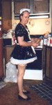 sissy maid works in kitchen